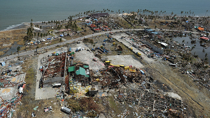 This aerial photo shows destroyed houses in the city of Tacloban, Leyte province, in the central Philippines on November 11, 2013, only days after Super Typhoon Haiyan devastated the town on November 8. (AFP Photo / Ted Aljibe)