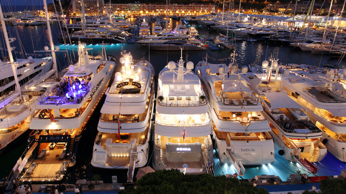 A picture taken in the principalty of Monaco, shows yachts moored at Port Hercules. (AFP Photo / Valery Hache)