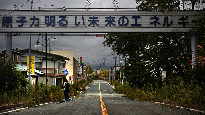 "A sign reading ""Nuclear Power - The Energy for a Better Future"", at the entrance of the empty Futaba town, inside the exclusion zone in Fukushima prefecture September 22, 2013. (Reuters / Damir Sagolj)"