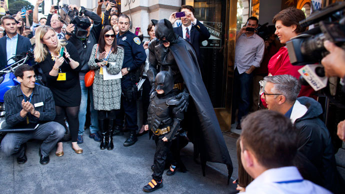 Leukemia survivor Miles, 5, dressed as BatKid, and Batman leave a former bank after arresting the Riddler as part of a Make-A-Wish foundation fulfillment November 15, 2013 in San Francisco.(AFP Photo / Ramin Talaie)