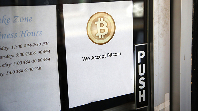 A Bitcoin logo is seen at the window of Sake Zone, a restaurant that accepts Bitcoin in San Francisco, California October 9, 2013. (Reuters / Stephen Lam)