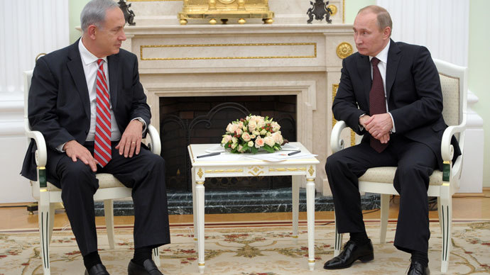 Russia's President Vladimir Putin (R) speaks with Israel's Prime Minister Benjamin Netanyahu during their meeting in Moscow's Kremlin, on November 20, 2013. Netanyahu arrived today in Moscow.(AFP Photo / Alexei Nikolsky)