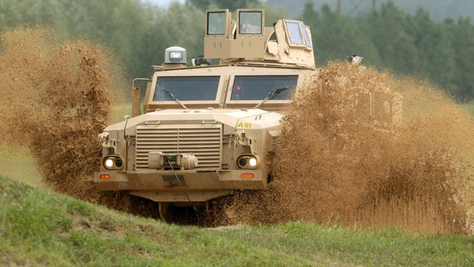 A Mine Resistant Ambush Protected (MRAP) Classification One vehicle demonstrates its off-road abilities in a water puddle at the U.S. Army's Aberdeen Proving Grounds in Aberdeen, Maryland (Reuters/Larry Downing)