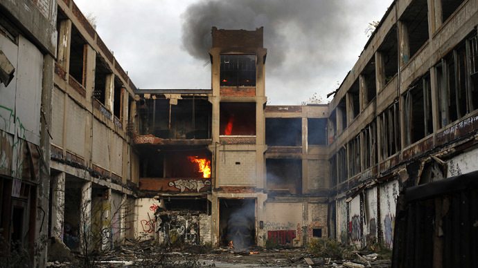 Smoke and flames rise from a deteriorating building at a former Packard plant in Detroit, Michigan October 25, 2013. (Reuters/Joshua Lott)