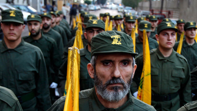 Lebanon's Hezbollah militants hold flags.(Reuters / Jamal Saidi)