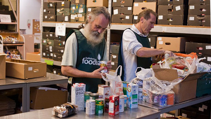 Volunteers sort through donations of food at the headquarters of the Trussell Trust Foodbank Organisation in Salisbury, southern England (AFP Photo / Will Oliver)