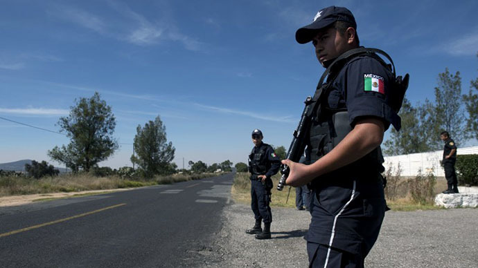 "Federal policemen stand guard in front of the National Institute for Nuclear Research (ININ) — the destination of the truck transporting a ""teletherapy source"" containing cobalt-60 which was stolen by gunmen on December 2 — in Maquixco, Mexico state on December 4, 2013. (AFP Photo / Yuri Cortez)"