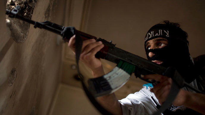 A Rebel fighter aims his weapon during fighting against Syrian government forces.(AFP Photo / Jm Lopez)