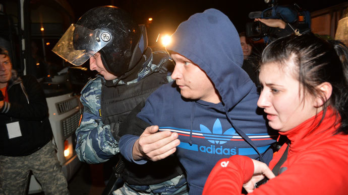 "Police officers detain participants in ""people's gathering"" in Moscow's Biryulyovo district. Local residents urge the authorities to find the murderers of Yegor Shcherbakov.(RIA Novosti / Iliya Pitalev)"