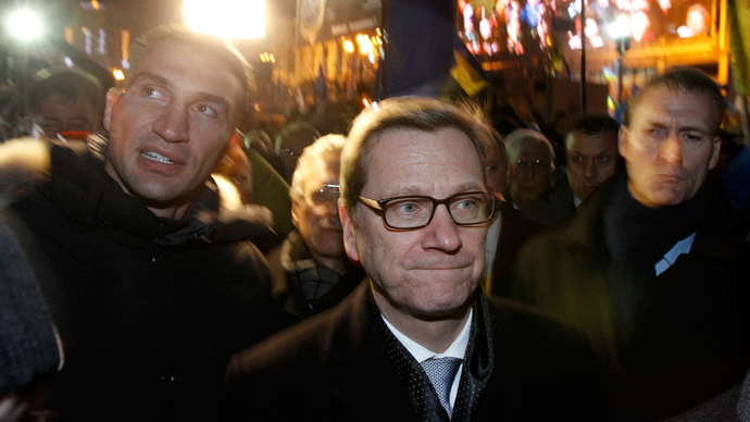German Foreign Minister Guido Westerwelle (C) and heavyweight boxing champion and UDAR (Ukrainian Democratic Alliance for Reform) party leader Vitali Klitschko (L) walk along Independence Square in Kiev December 4, 2013.  (Reuters / Vasily Fedosenko)