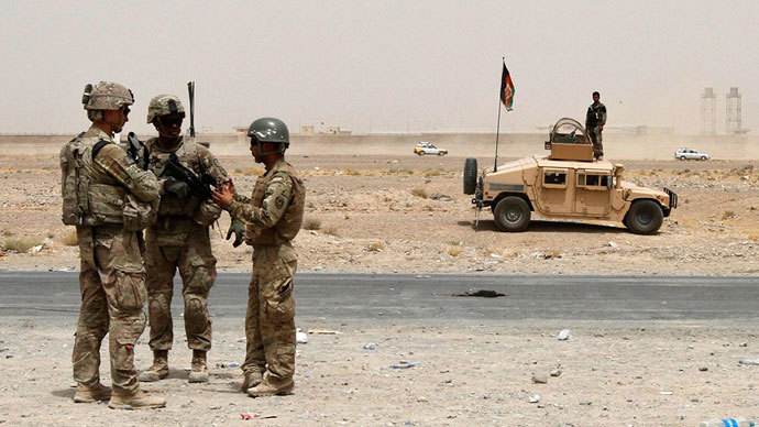 U.S troops, part of the NATO-led International Security Assistance Force (ISAF), arrive at the site of a suicide attack in Kandahar.(Reuters / Ahmad Nadeem)