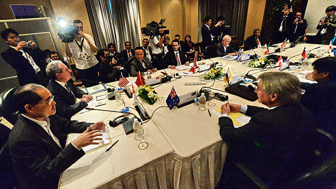 Trade ministers and representatives attend the Trans-Pacific Partnership (TPP) Ministerial Meeting in Singapore on December 7, 2013. (AFP Photo / Roslan Rahman)