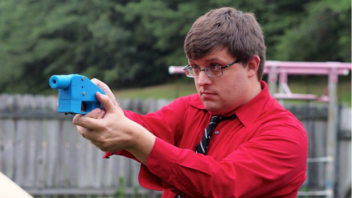 Software engineer Travis Lerol takes aim with an unloaded Liberator handgun in the backyard of his home. The Liberator is the first gun that can be made entirely with parts from a 3D printer and computer-aided design (CAD) files downloaded from the Internet. (AFP Photo / Robert MacPherson)
