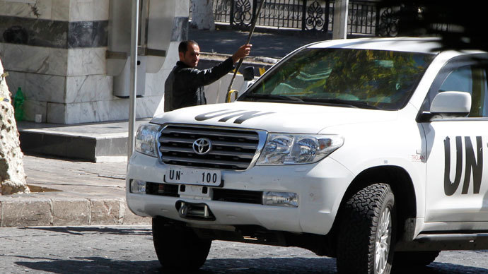 A U.N. vehicle returns to a hotel where experts from the Organisation for the Prohibition of Chemical Weapons (OPCW) are staying, in Damascus.(Reuters / Khaled al-Hariri)
