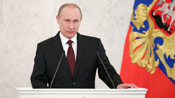 Russian President Vladimir Putin delivers an annual state of the nation address at the Kremlin in Moscow, on December 12, 2013.(AFP Photo / Mikhail Metzel)