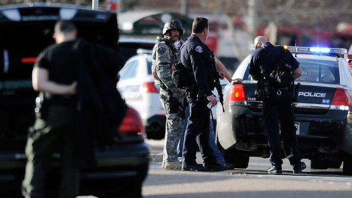 Police officers work outside Arapahoe High School after a school shooting on December 13, 2013 in Centennial, Colorado on Friday Dec. 13, 2013. (AFP Photo / Chris Schneider)