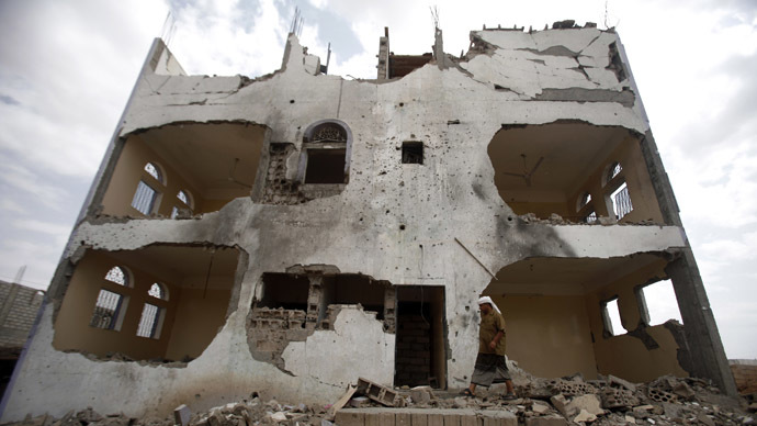 A tribesman walks near a building damaged last year by a U.S. drone air strike targeting suspected al Qaeda militants in Azan of the southeastern Yemeni province of Shabwa February 3, 2013. (Reutres/Khaled Abdullah)