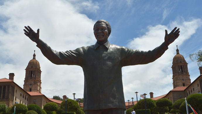 A 9-meter bronze statue of South African former president Nelson Mandela is unveiled on December 16, 2013 on the lawns of the Union Buildings, the seat of government in Pretoria where Mandela was inaugurated as South Africa's first black president in 1994 (AFP Photo / Alexander Joe)
