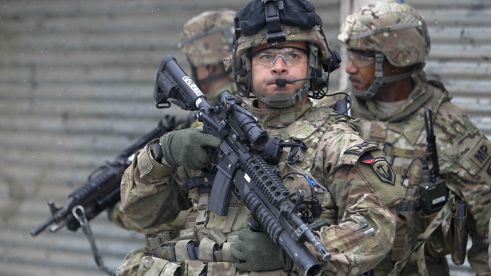 U.S. troops with the NATO-led International Security Assistance Force (ISAF) keep watch at the site of a suicide attack in Kabul, February 27, 2013. (Reuters/Omar Sobhani)