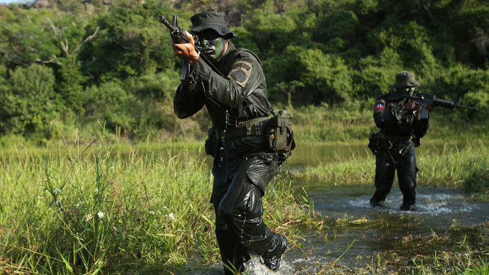 Policemen take part in training during the Jungla International Course, in Chicoral near Ibague.(Reuters / John Vizcaino)
