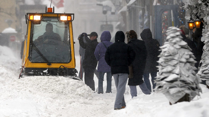 A snow plow cleans the sidewalk during a snowstorm in Quebec City December 22, 2013. (Reuters/Mathieu Belanger)