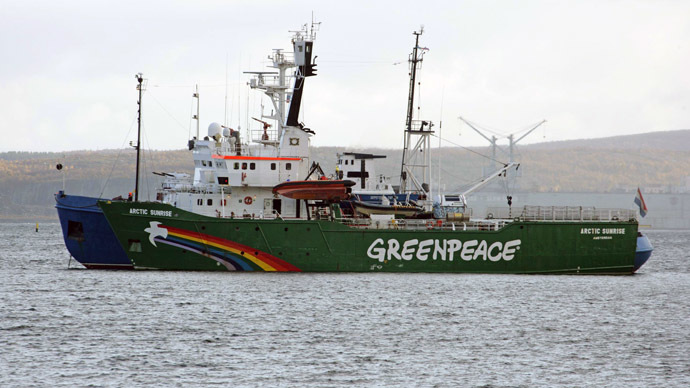 A handout photo provided by Greenpeace International shows the Greenpeace ship, Arctic Sunrise, being towed on September 24, 2013 into the Russian port of Murmansk by a Russian Coast Guard vessel. (AFP/Greenpeace)