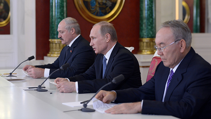 Presidents Vladimir Putin (center) of Russia , Alexander Lukashenko (left) of Belarus and Nursultan Nazarbayev (right) of Kazakhstan making a statement for the press after the end of the Supreme Eurasian Economic Council meeting in the Kremlin on December 24, 2013. (RIA Novosti / Aleksey Nikolskyi)