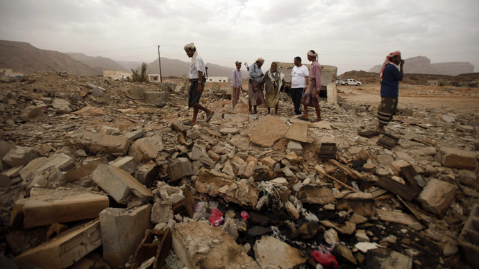 Tribesmen stand on the rubble of a building destroyed by a U.S. drone air strike, that targeted suspected al Qaeda militants in Azan of the southeastern Yemeni province of Shabwa February 3, 2013. (Reuters/Khaled Abdullah)