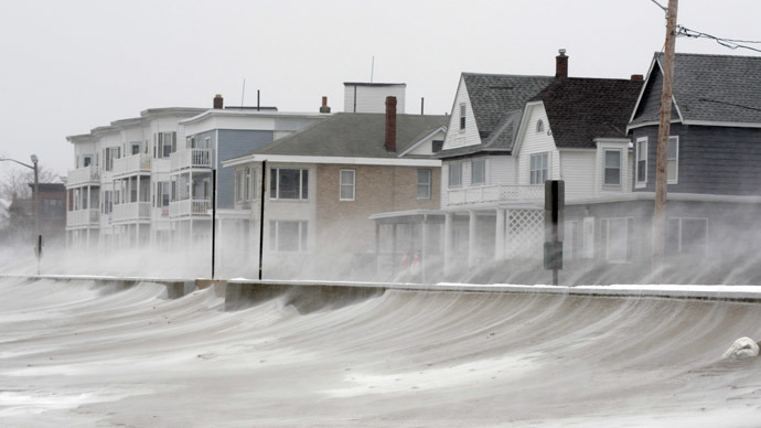 Winds whip snow from the beach across Winthrop Shore Drive January 2, 2014 in Winthrop, Massachusetts. (Darren McCollester/Getty Images/AFP)