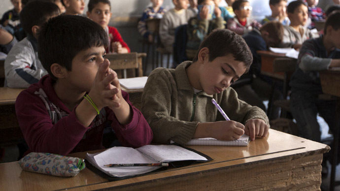 Students attend a class at a school in Aleppo's Bustan al-Qasr (Reuters/Mahmoud Hassano)