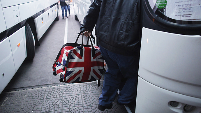 A man carrying a bag adorned with a British Union Jack flag steps into a bus departing from Sofia's central bus station to London via Austria, Germany and France January 2, 2014. (Reuters / Stoyan Nenov)