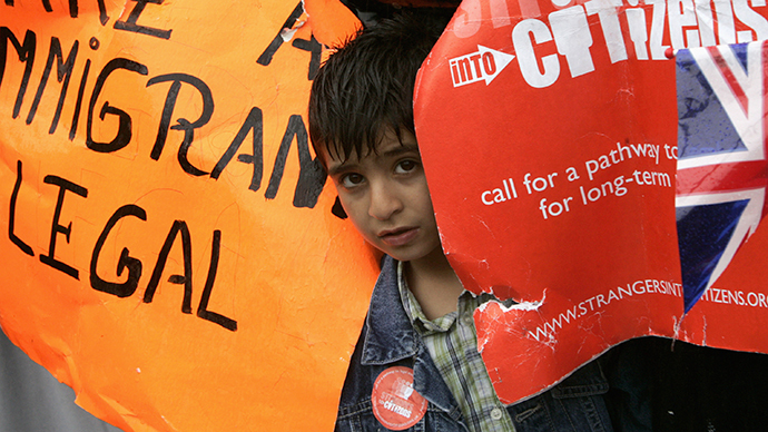 A child peers out during the migrant's day march for immigrant rights in Trafalgar Square (Reuters / Luke MacGregor)