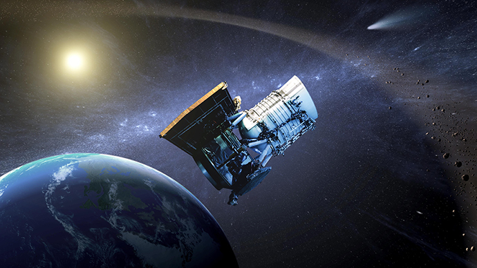 This artist's concept shows the Wide-field Infrared Survey Explorer, or WISE spacecraft, in its orbit around Earth. In September of 2013, engineers will attempt to bring the mission out of hibernation to hunt for more asteroids and comets in a project called NEOWISE. (NASA/JPL-Caltech)