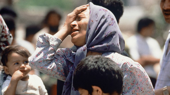 An elderly Palestinian woman mourns 27 May 1985 a member of her family killed in the fighting between Palestinian guerrillas and Amal Shi'ite militia in Sabra Palestinian refugee camp in the southern West Beirut. (AFP Photo / Joel Robine)