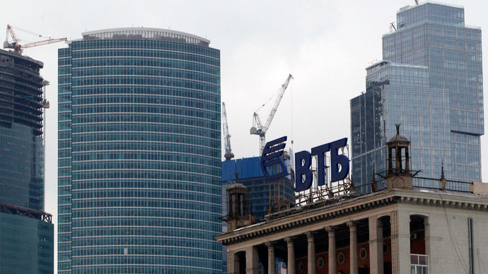 "The logo of VTB Bank is displayed on the roof of a building, with towers of the Moscow International Business Center, also known as ""Moskva-City"", seen in the background, in Moscow.(Reuters / Sergei Karpukhin)"