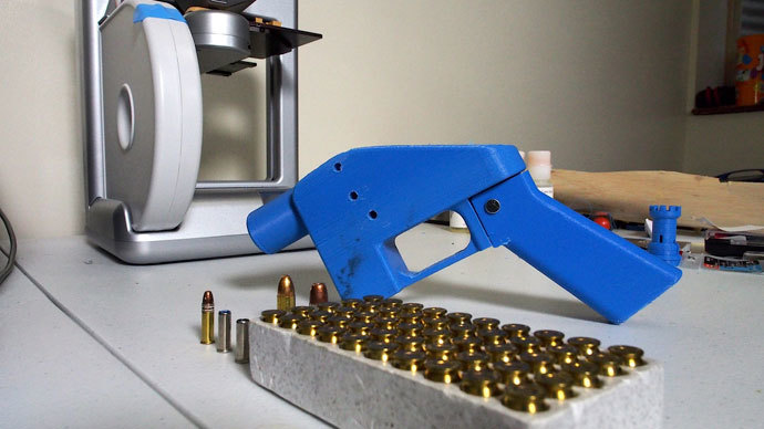 A Liberator pistol appears on July 11, 2013 next to the 3D printer on which its components were made. The single-shot handgun is the first firearm that can be made entirely with plastic components forged with a 3D printer and computer-aided design (CAD) files downloaded from the Internet.(AFP Photo / Robert MacPherson)