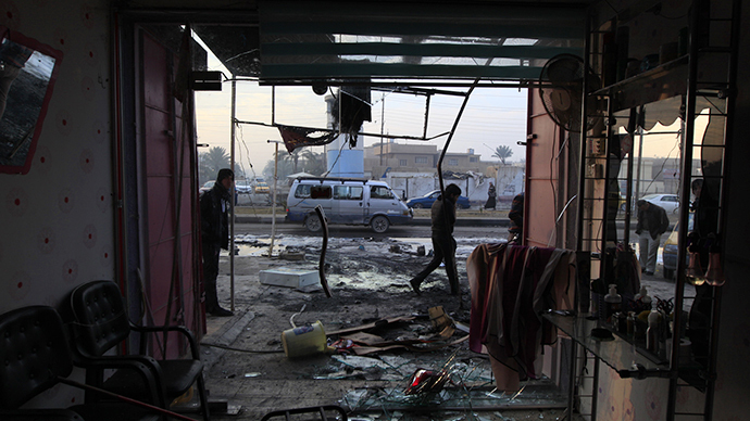People gather at the site of a car bomb attack in Baghdad's Ghazaliya district, January 15, 2014. (Reuters / Ahmed Saad)