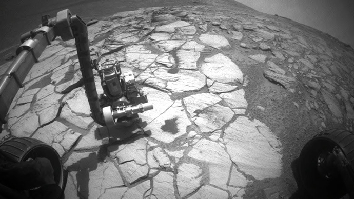 NASA Mars Exploration Rover Opportunity used its front hazard-indentification camera to capture this wide-angle view of its robotic arm extended to a rock in a bright-toned layer inside Victoria Crater. Image credit: NASA/JPL-Caltech