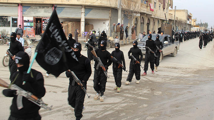 Fighters of al-Qaeda linked Islamic State of Iraq and the Levant parade at Syrian town (Reuters / Yaser Al-Khodor)
