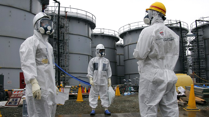 A Tokyo Electric Power Corp.'s (Tepco) official stands at H4 tank area, at the Fukushima Dai-ichi nuclear power plant in Okuma, Fukushima Prefecture, Japan (AFP Photo / Kimimasa Mayama)