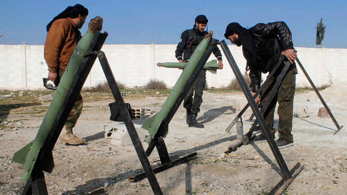 Fighters from the Free Syrian Army's Saif al-Umayyad brigade prepare rockets to be launched towards forces loyal to Syria's President Bashar al-Assad in the eastern Damascus suburb of Ghouta January 16, 2014. (Reuters / Rafat Beram)