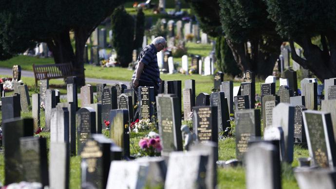 A man walks through a cemetery in Nottingham, central England (Reuters/Darren Staples)