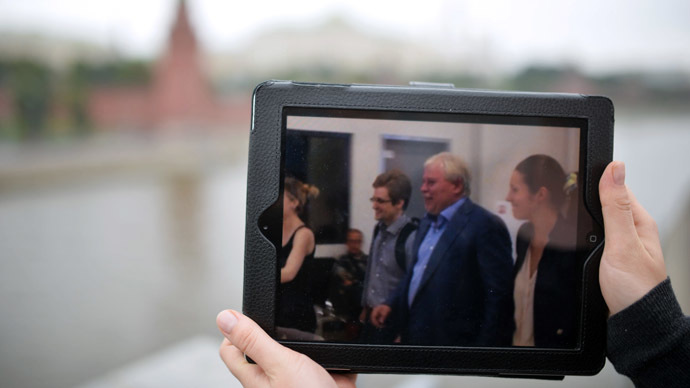 This tablet PC displays a photo of former CIA employee Edward Snowden and his lawyer Anatoly Kucherena leaving the Sheremetyevo airport.  (RIA Novosti/Iliya Pitalev)