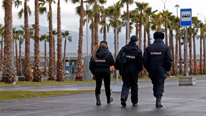 Police officers walk near the Olympic Park in the Adler district of Sochi January 18, 2014. (Reuters / Alexander Demianchuk)