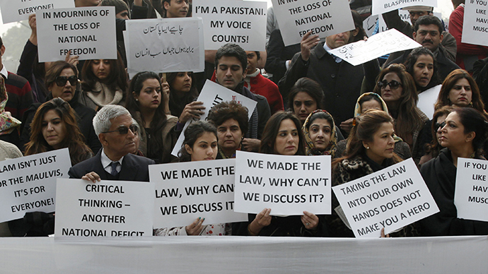 ARCHIVE PHOTO. Residents hold placards during a rally protesting the killing of the Governor of Punjab Salman Taseer in Lahore, Taseer was shot dead by one of his guards, who was apparently incensed by the politician's opposition to the blasphemy law. (Reuters / Mohsin Raza)