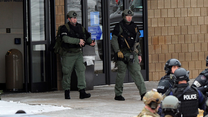 Police gather outside a Sears store at the Columbia Mall after a fatal shooting on January 25, 2014, in Columbia, Maryland. (AFP Photo/Jewel Samad)