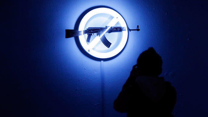 "A visitor looks at Langlands & Bell's ""Sign of the Times"", at the AKA Peace exhibition at the Institute for Contemporary Art (ICA) in central London.(Reuters / Andrew Winning)"