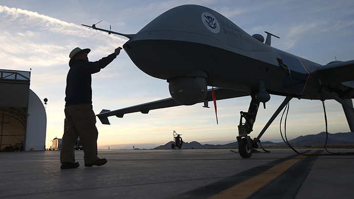 Maintenence personel check a Predator drone operated by U.S. Office of Air and Marine (OAM), before its surveillance flight near the Mexican border. (AFP Photo / John Moore)
