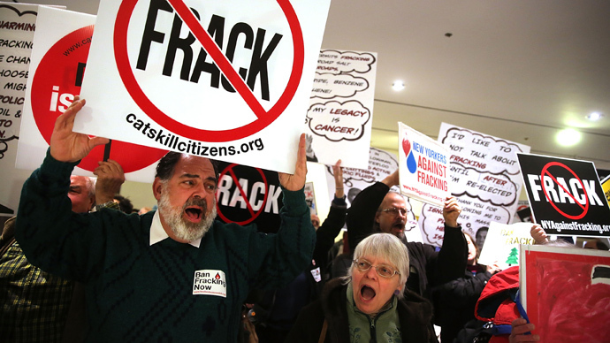 Anti-fracking protesters gather outside of the auditorium before New York Gov. Andrew Cuomo gives his fourth State of the State address (Spencer Platt / Getty Images / AFP)