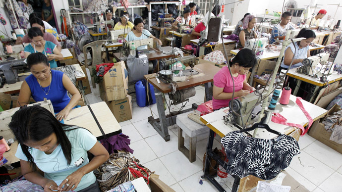 Garment workers sew maternity dresses at a factory of Additional Pelf Joys Trading Corp. at Taytay city, Rizal province, east of Manila May 1, 2013. (Reuters/Romeo Ranoco)